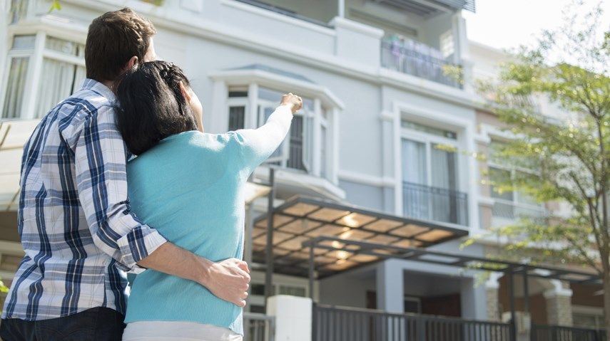 Young buyers buying condo apartment