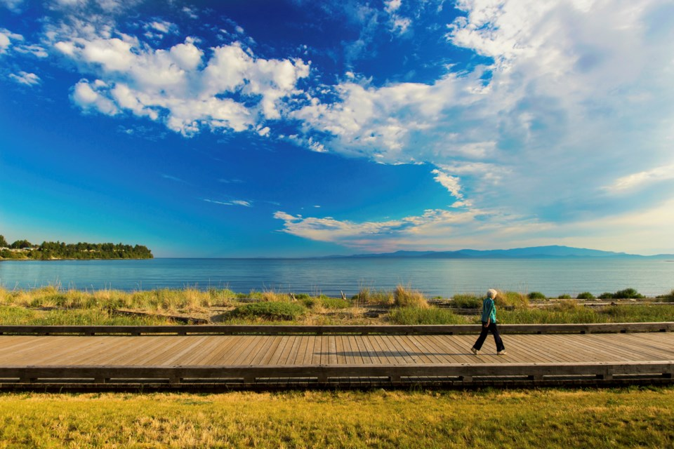 A boardwalk stretches alongside the Beach Club Resort in Parksville.