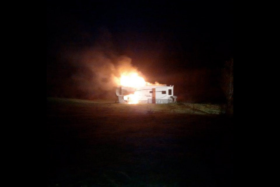 Firefighters had to hose down and disconnect two propane tanks that were attached to a fifth-wheel trailer that was fully engulfed in flames Wednesday morning, Fire Chief Steve Sorensen said. It took about two hours to put the fire out.
