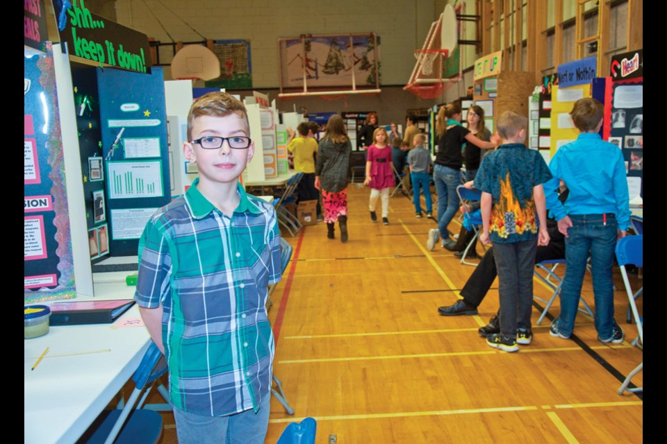 Grade 5 Charlie Lake Elementary student Mason Maddigan successfully extracted iron from a variety of breakfast cereals for his science fair project. Maddigan was one of 131 students who presented their projects at the school's science fair Tuesday.