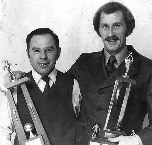 Hans Niedermayer, left, shows off the hardware with Neil Edelmann after they were selected as the most outstanding players in the North Cariboo League in 1969.