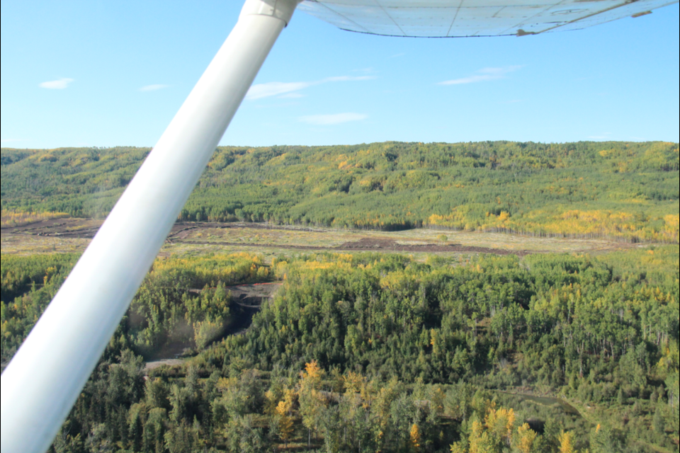 The Site C North Bank construction site, seen from the air last September. Pilots in this area will now have to fly at 3,000 feet, after BC Hydro requested restricted airspace for blasting work.