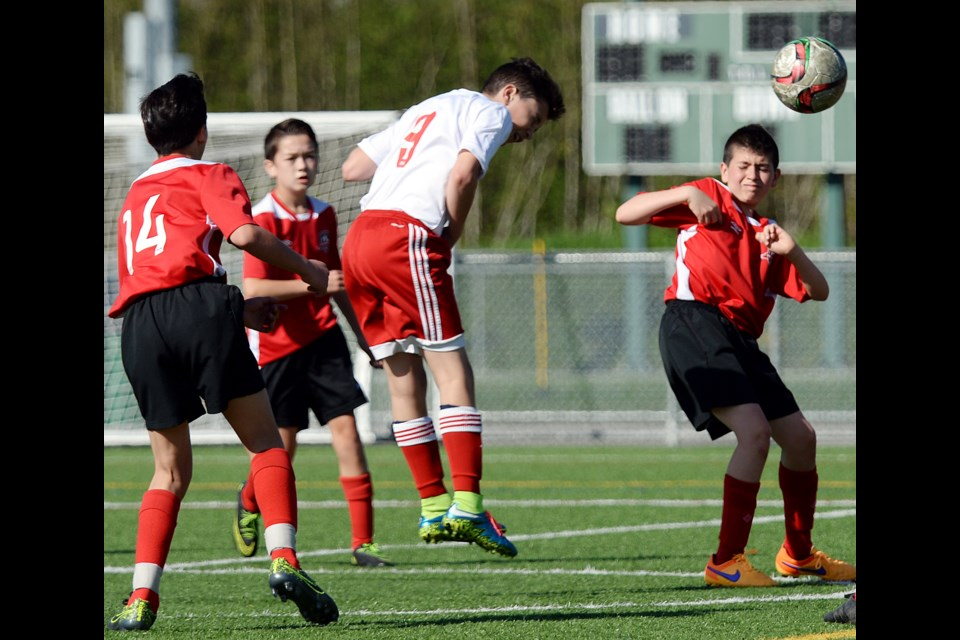 Burnaby Metro Selects striker Joey Cannova heads the ball during last week's Coastal A Cup under-13 quarterfinal at Burnaby Lake West. Burnaby prevailed 2-0 over Port Moody to advance to this week's semifinal.