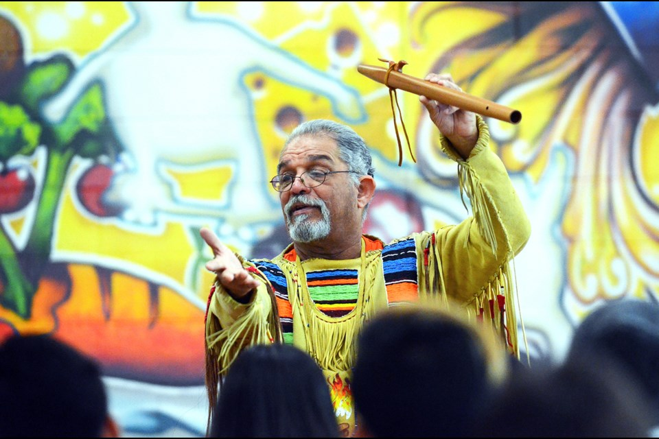 Indigenous storyteller and Surrey resident Old Hands tells students in the Burnaby North Secondary cafeteria a story about the origin of the Native American flute. The storyteller was at Burnaby North Monday as part of the school's second annual Day of Truth and Reconciliation.