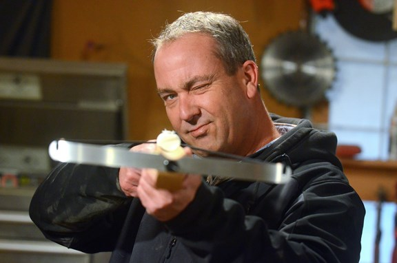 Burnaby craftsman Jeff Davidson takes aim with a marshmallow-shooting crossbow he designed and produces in a rented Burnaby garage. The novelty weapons were a big hit at the B.C. Rod and Gun Show in Cloverdale earlier this month.