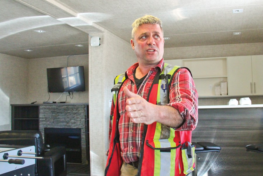 Stephen Bertoria, a construction officer with BC Hydro, in a trailer that serves as a lounge for staff while the main worker camp is being built. BC Hydro expects to acquire a liquor licence for the camp this summer.