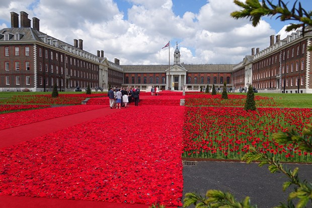 "Some 300,000 individually hand-crafted poppies covered nearly 2,000sq m (21,000sq ft) in front of the Royal Hospital Chelsea, which houses war veterans, in a display sponsored by Australia's Victoria State Government – based on an original project by Lynn Berry and Margaret Knight to crochet 120 poppies to ""plant"" at the Shrine of Remembrance in Melbourne."