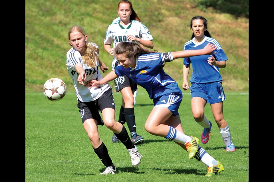 Handsworth's Sophia Verdicchio nudges past an Argyle defender while teammate Jade Fraser follows the play during a North Shore league game. The Royals raced all the way to the provincial final last week before falling 1-0 against Surrey's Fleetwood Park. photo by Paul McGrath, North Shore News