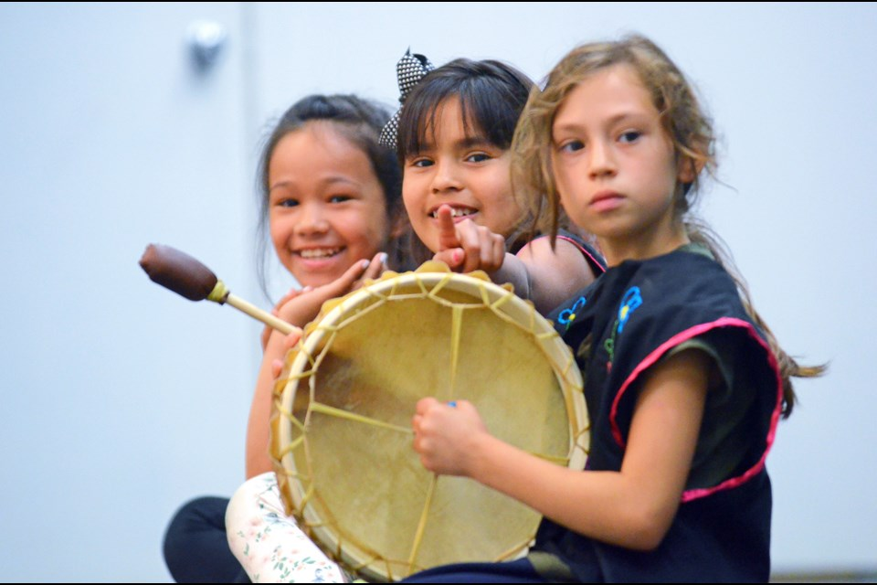 Stride Avenue Community School drummers Raveen Snow, Alesha Marsden and Maya Jir wait to perform on the Edmonds Community School gym stage during Burnaby's first National Aboriginal Day celebrations Tuesday.
