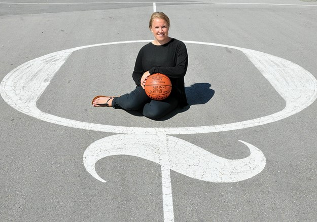 Jamie Keast finds peace on the Q court at North Vancouver's Queen Mary elementary. The court is one of three built around the Lower Mainland in honour of Jamie's twin brother Quinn, a beloved high school athlete who was killed in a pedestrian accident 10 years ago this month. photo by Paul McGrath, North Shore News