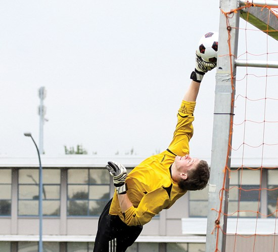 A goalkeeper makes an acrobatic save during last year's Les Sinnott Boys Memorial Cup. The provincial championship tournament will be played in West Van this year.