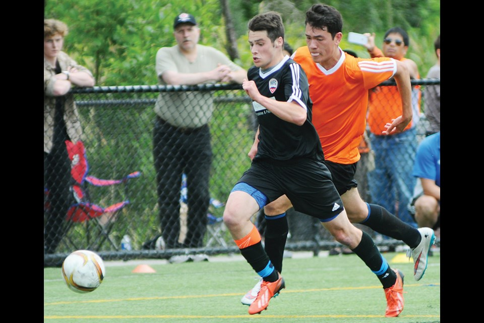 Alec Craven of the North Van FC Fury pulls away from a defender from Westminster United during a 3-1 win in the final of the Les Sinnott Memorial Boys Provincial Cup played Sunday at Ambleside Park. photo by Cindy Goodman, North Shore News