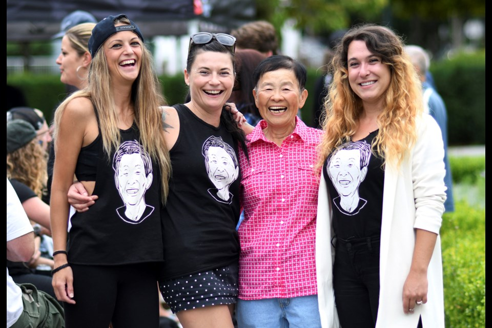 Monica Adey, Lynn McQuigge and Amy Byers pose with Joyce Wong while wearing T-shirts that bear her face. Photo Jennifer Gauthier