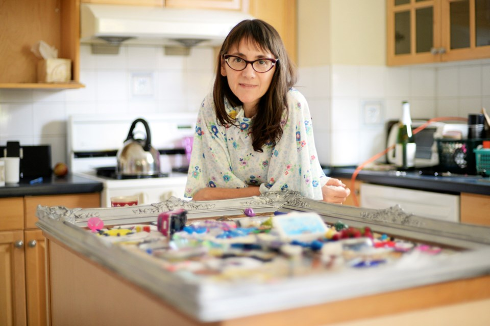 Leah Price hosts a three-day art exhibit out of her 10th Avenue home that serves as equal parts recycling class, therapy session and moving party all in one. Photo Jennifer Gauthier