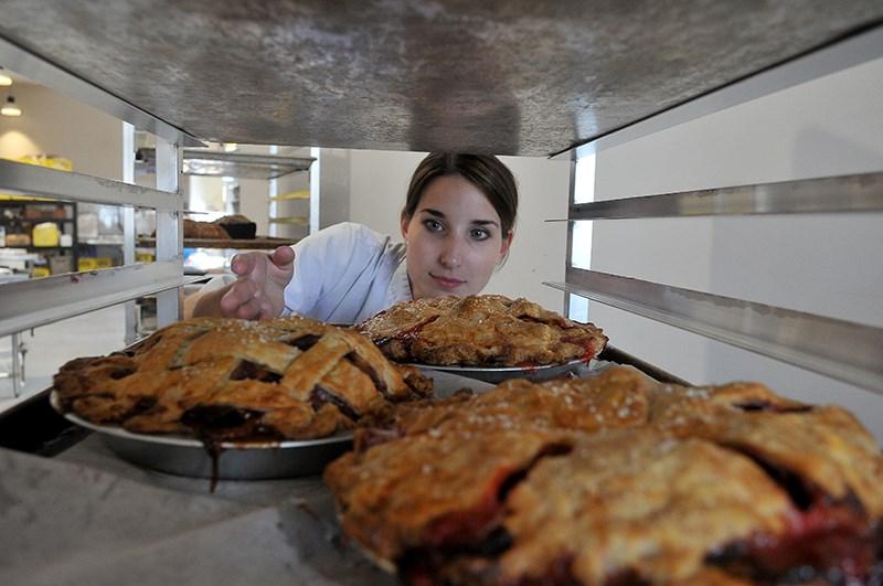 Justine Perks organizes the pie rack at Gabi & Jules