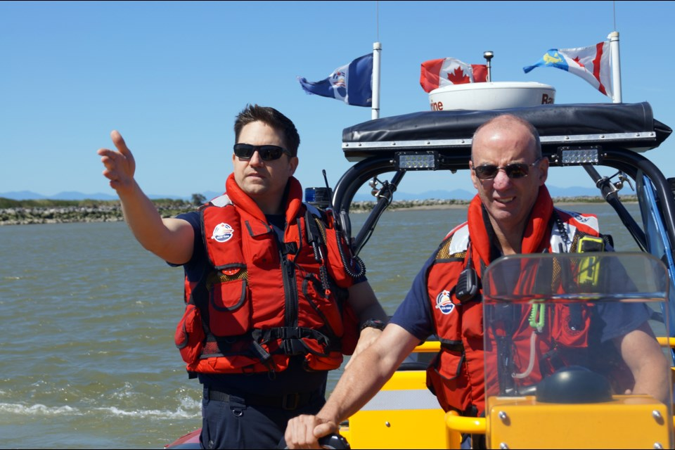 Volunteer search and rescue crew member, coxswain Kevin Robertson, left, leads advanced crew member Jim Heineky on a training exercise. The Royal Canadian Marine Search and Rescue team operates two boats on the river. Photo by Graeme Wood/Richmond News