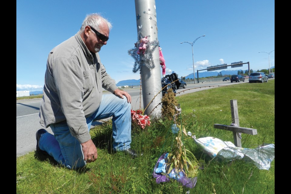 Ron Mahy at the memorial site on Sea Island near where his daughter, Christy, was struck and later died of her injuries on July 30, 2014. The police have yet to lay charges in the matter. File photo