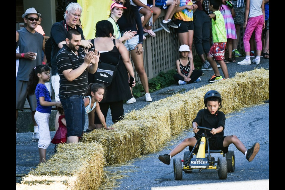Adults and children raced in Friday's third annual Ray-Cam Soapbox Derby. The racetrack was in the alley behind Ray-Cam Co-operative Centre and was organized in partnership with the Vancouver Police Department. The soapbox racers are built by youth in the NASKARZ program at Vancouver Community College.