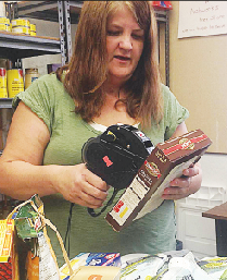 Program director Jacqueline Janssen process food at the food bank at the Networks Ministries.