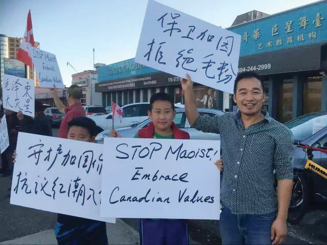 The Alliance of the Guard of Canadian Values, led by Loius Huang, far right, protested outside Stage One Academy in Richmond, where other ethnic Chinese groups were hosting a concert to mark the 40th anniversary of the death of former Chinese leader Chairman Mao.