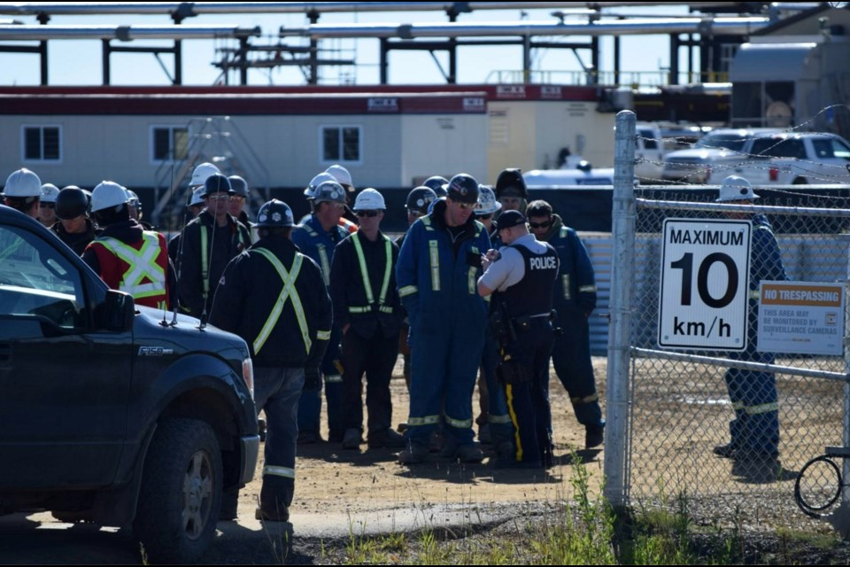 RCMP officers take statements from Encana employees at the company's water resource hub in the Farmington-Bessborough area, Sept. 12.