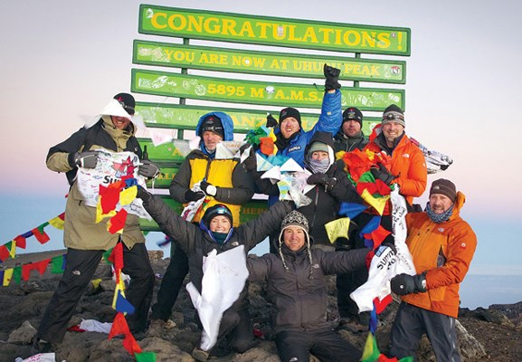 The 2012 Kilimanjaro Summits of Hope team celebrate their ascent. Seated in the middle of the front row is Ridgeview elementary vice-principal Craig Cantlie and in the back row, second from right, is North Vancouver resident Jason Lawson.