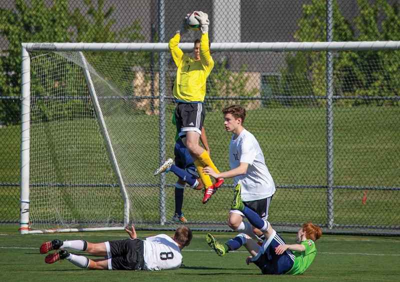 Goalie Sam Boppart leaps to make a grab during a game with Mountain United's U16 team. photo supplied