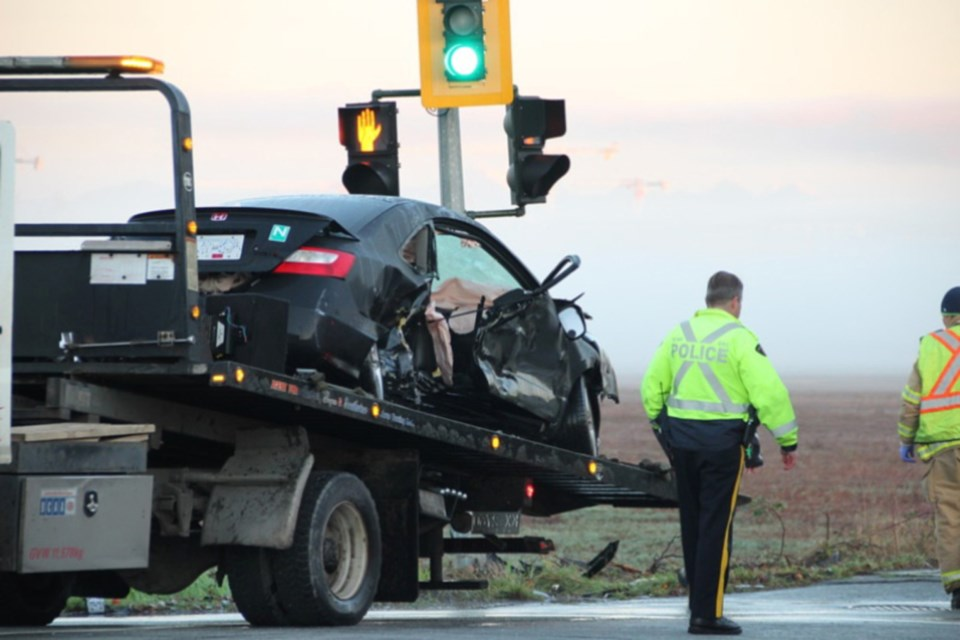 The Honda Civic involved in Sunday morning's fatal crash is towed away