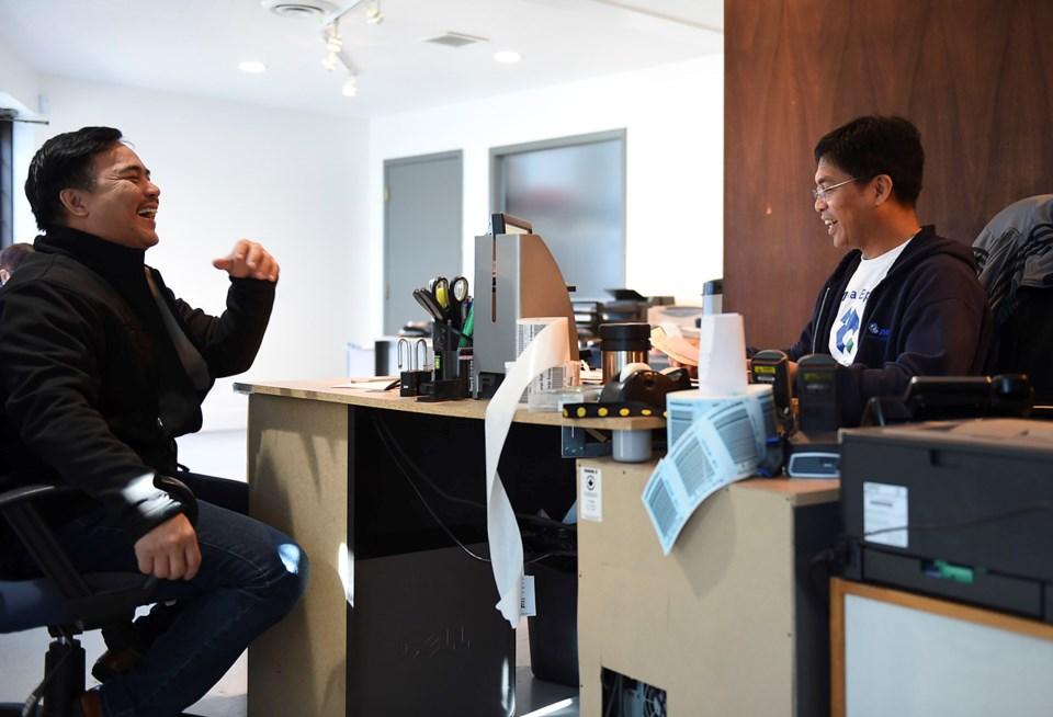 Noemi Tabrilla deals with a customer in his Richmond office. In 2015, Filipinos sent $25.8 billion i