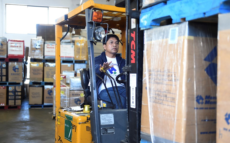 In a warehouse in Richmond, every balikbayan box sent through Manila Cargo Express passes under Noem