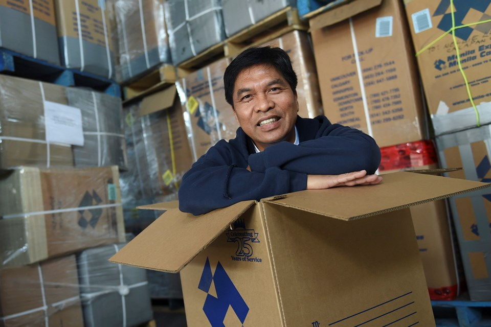 Noemi Tabrilla oversees the thousands of care packages known as balikbanyan boxes that make their way from Canada to the Philippines. Photo Dan Toulgoet