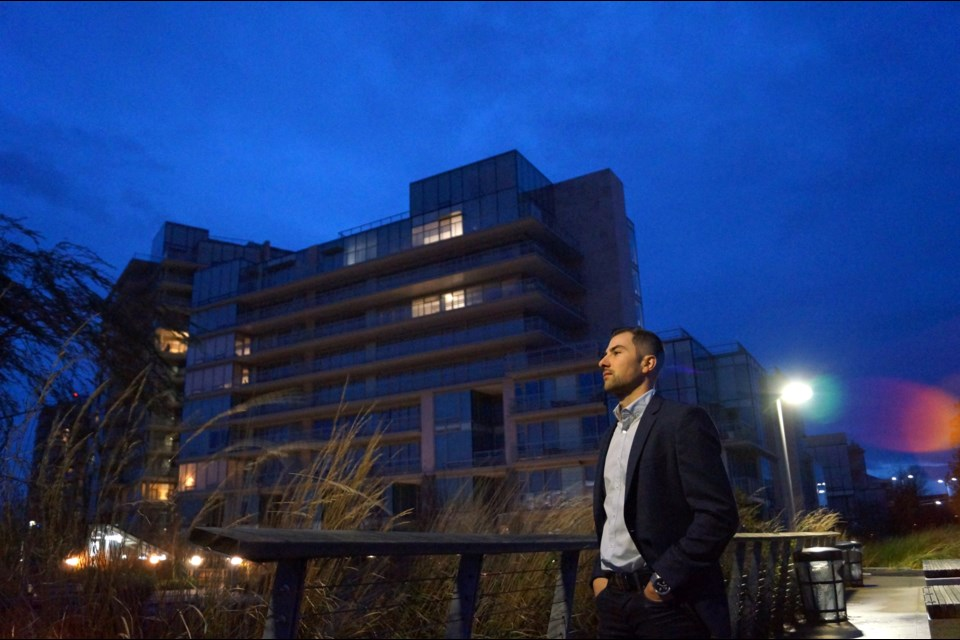 Richmond-born realtor Steve Saretsky stands in front of the four-year-old River Green development, which appears more empty than occupied.