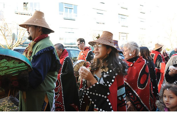 The Aboriginal Mother Centre marked its official opening Friday with the raising of a totem pole at the centre's location at 2019 Dundas St.