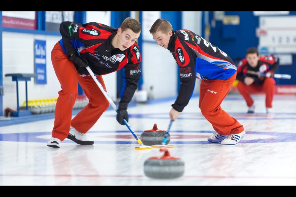 Jordan Tardi and Sterling Middleton move down ice during early round action at last week's B.C. junior men's curling championship in New Westminster.