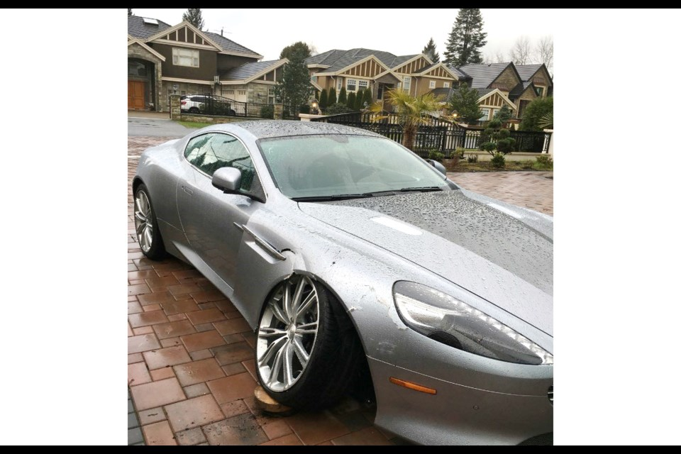 Jessica Liu's 2014 Aston Martin DB9, with its Skyfall silver paintjob, sits inoperable in the driveway of her home near Blundell and No. 2 roads in December of 2015. Liu claims she's being overcharged by the autoshop that specializes in fixing Aston Martins.