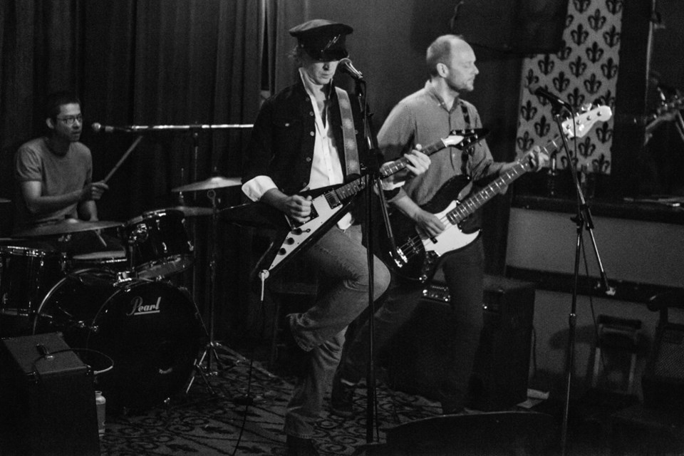 Polly performs live at LanaLou's in Vancouver in 2015 with Paul Leahy, middle, drummer Eric Lowe and bassist Eric Cottrell.