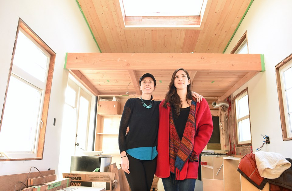 Anastasia Koutalianos and Samantha Gambling (right) cofounded the B.C. Tiny House Collective in July