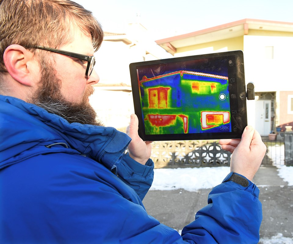 Chris Higgins, a green building planner for the City of Vancouver, demonstrates how a thermal imagin