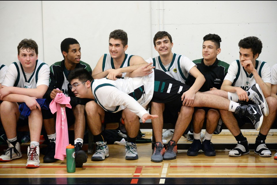 King George Dragon Nikan Najafi makes the most of the bench during in the senior boys AA/AAA city championship at Windermere secondary Feb. 10, 2017. Photo Jennifer Gauthier. Read story here.
