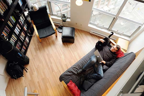 Martin Knowles in his apartment on Seymour Street, shot from the loft.