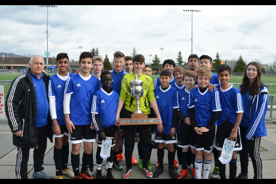 The Royal City boys under-14 Impact won its league title and the district Pioneer Cup, beating Squamish 2-1 in penalty kicks.