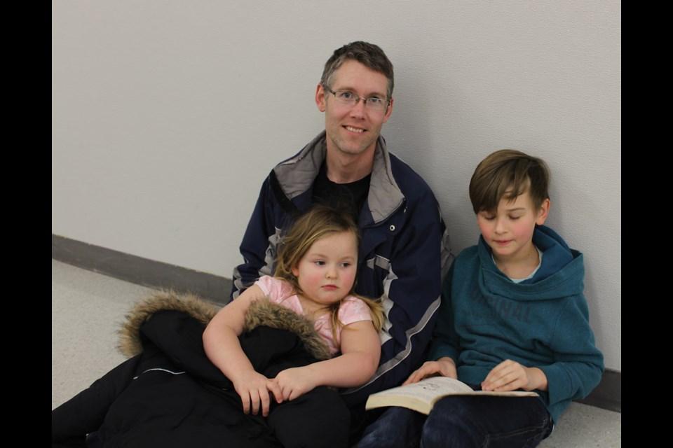 Allan Chapman with his children Zander and Mya, Feb. 23 at Goulter School.