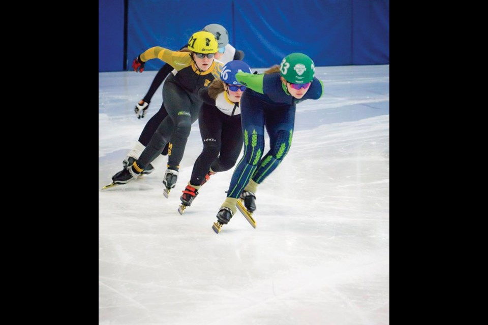 Seven years of speed skating paid off for Virden teen Kennedy Charles (front) as she medaled four times at the Games.