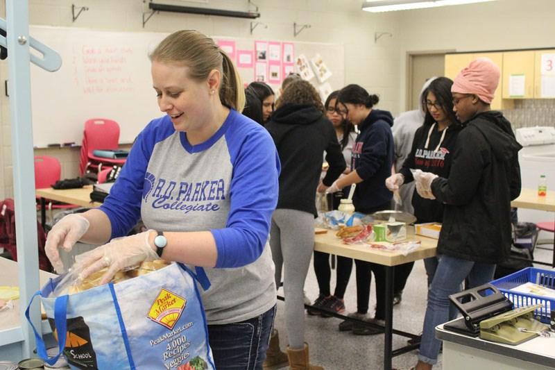 R.D. Parker Collegiate teacher Amanda Stillie packs away some sandwiches April 10 for H3's new free