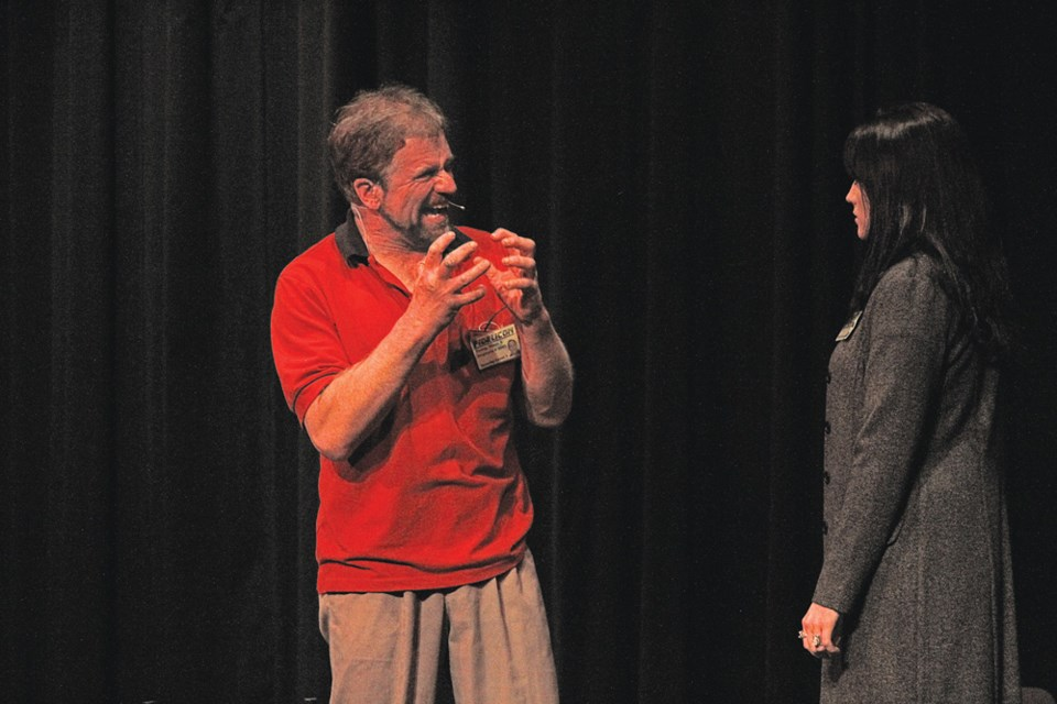 """Virden playwright and actor/director George Baker in the closing moments of his drama, """"F2764"""". In his role, Baker is deeply conflicted as a bereaved and lonely husband and the architect of a beautiful robotic dream girl. Playing opposite Monelle Lestrat - his boss - he expresses his innermost anguish."""