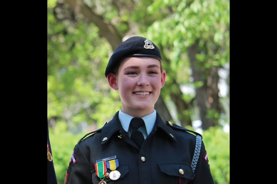 Our Smile of the Week: Warrant Officer Eduarda Gibbert flashed a big grin as she received an award at the XII Manitoba Dragoons ceremonial review in Virden last Sunday.