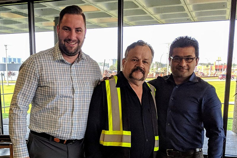 Jimmy Pelk (left) and Siddhartha Varma (right) of fledgling bus service provider Thompson Bus pose w