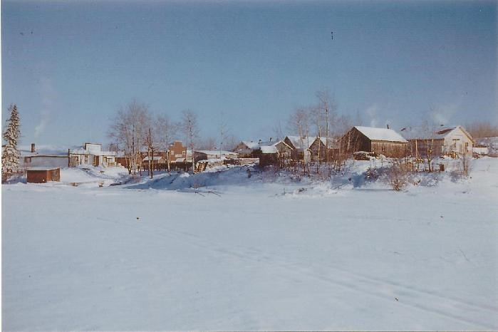 Winter in the community of Herb Lake and the Rex Mine headframe.