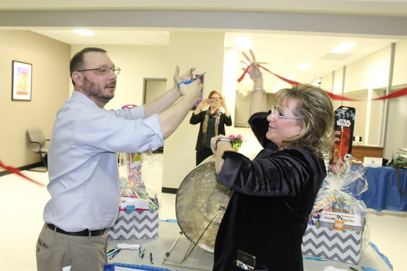 Acting Manitoba ombudsman Marc Cormier and head Manitoba advocate for child and youth Daphne Penrose celebrate the grand opening of their shared office in Thompson with a ribbon-cutting ceremony April 16.