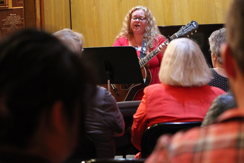 """Amy Caldwell performs """"Lovers in a Dangerous Time"""" by the Barenaked Ladies Saturday at the Heritage North Museum."""